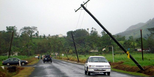 NADUNA, FIJI - MARCH 16 : (EUROPE AND AUSTRALASIA OUT) Poles carrying power lines lean precariously along...