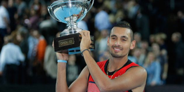 Nick Kyrgios of Australia holds his trophy after defeating Marin Cilic of Croatia, during their final match, at the Open 13 Provence tennis tournament, in Marseille, southern France, Sunday Feb. 21, 2016. (AP Photo/Claude Paris)