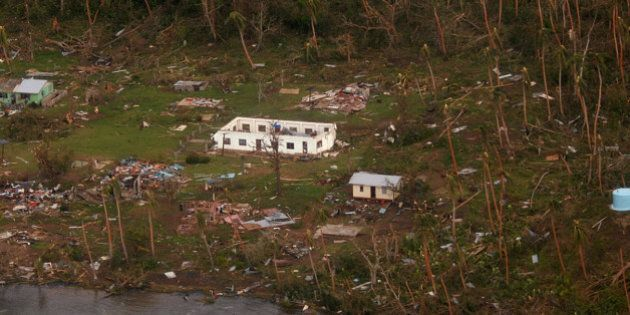 In this Sunday, Feb. 21, 2016 aerial photo supplied by the New Zealand Defense Force, debris is scattered...