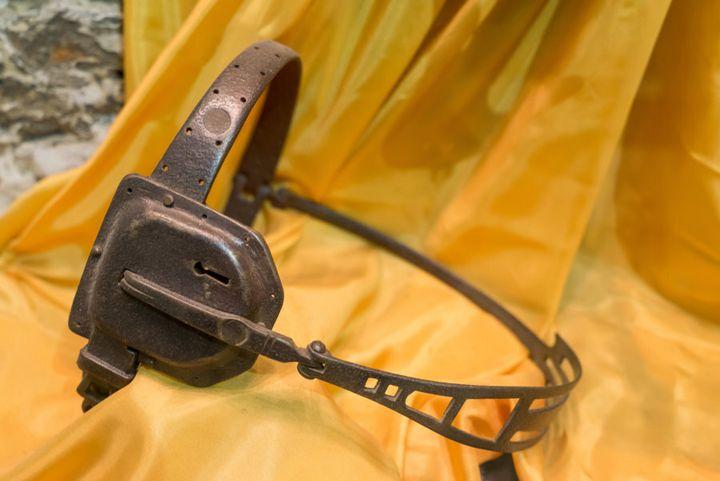 A metal medieval female chastity belt.