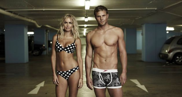 Lara Bingle and Andrew Lauterstein modelling modern Speedos in a car park. We don't know why. Maybe there's...