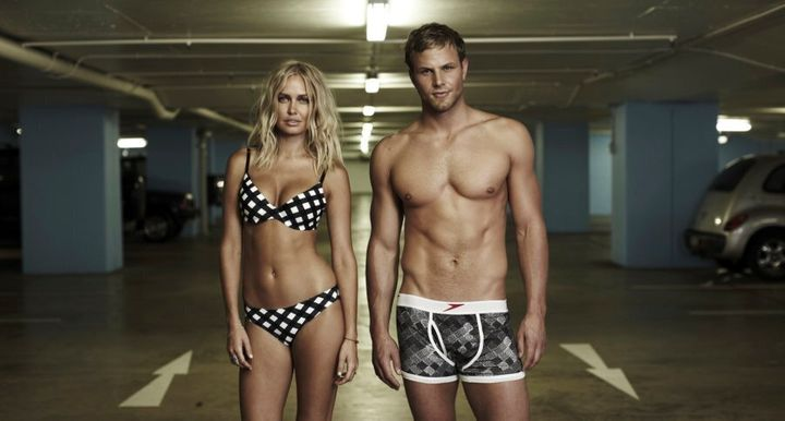 Lara Bingle and Andrew Lauterstein modelling modern Speedos in a car park. We don't know why. Maybe there's an underground pool nearby?