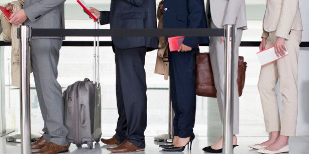 Business people standing in queue at airport