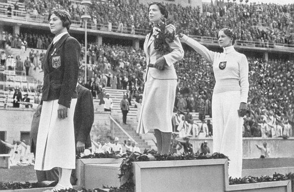 Helene Mayer giving the Nazi salute on the Olympic podium.