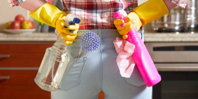 Girl preparing to spring clean kitchen