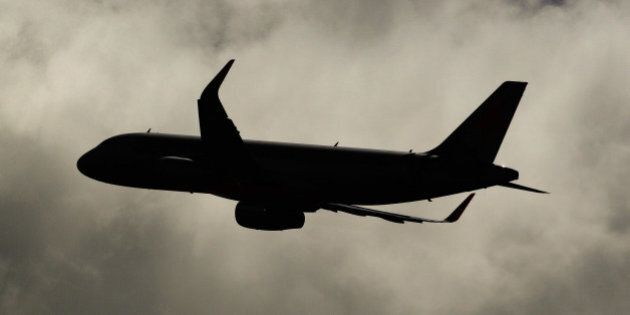 An Airbus SAS A321 aircraft operated by Jetstar Airways, the budget arm of Qantas Airways Ltd., is silhouetted...