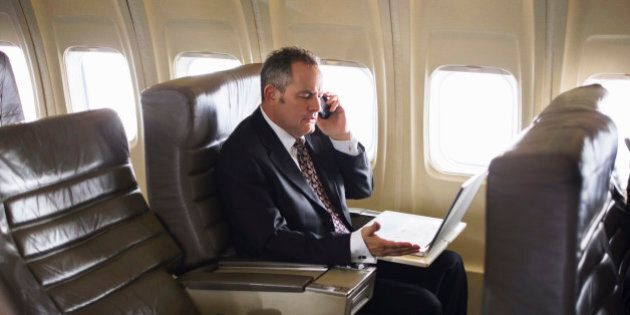 man wearing suit using cell phone on