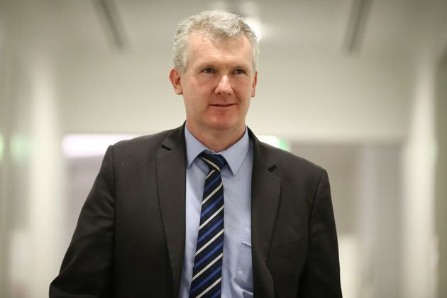 A 25-year-old, ambitious young foot soldier Tony Burke worked