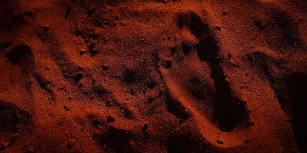 Footprint of a child during the closing ceremony in the Mutitjulu community of the First Nations National Convention held in Uluru.