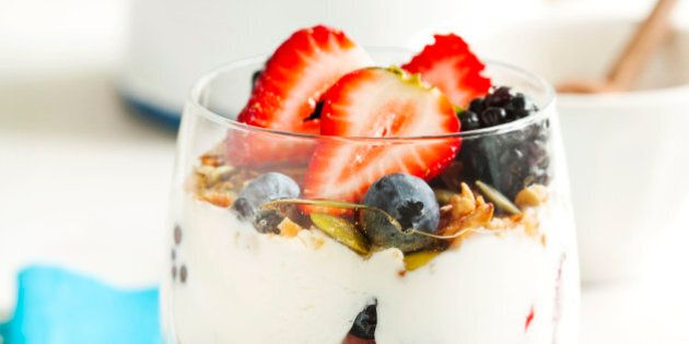 Homemade granola with yogurt, fresh berry and