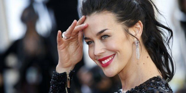 Australian model Megan Gale poses as she arrives for the screening of the film 'Youth' at the 68th Cannes...