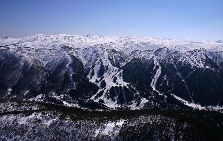 The slopes of Thredbo with Mt Kosciuszko (white hump, just to the right of middle) in the background.