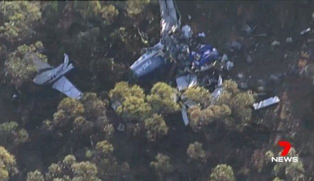 Footage taken from a Channel 7 helicopter shows the mangled wreck of the light plane which crashed with three people on-board on Tuesday night.