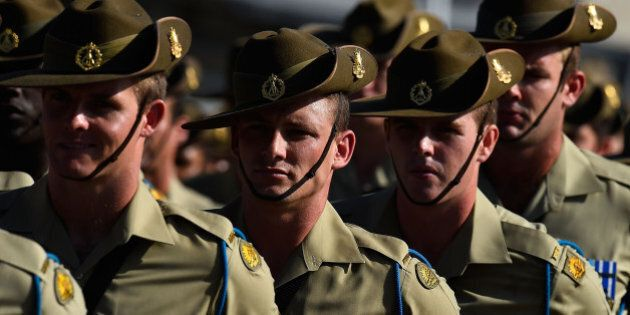TOWNSVILLE, AUSTRALIA - NOVEMBER 23: Australian soldiers from the Royal Australian Regiment march onto the parade ground at Lavarack Barracks on November 23, 2015 in Townsville, Australia. This month marks the 70th Anniversary of the formation of the 65th, 66th and 67th Battalions, later to be the 1st, 2nd and 3rd Battalions, The Royal Australian Regiment. (Photo by Ian Hitchcock/Getty Images)
