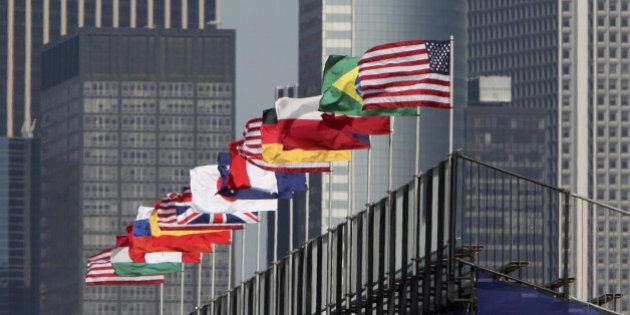 'Flags of various nations on grandstand fluttering in the wind, New York City.'