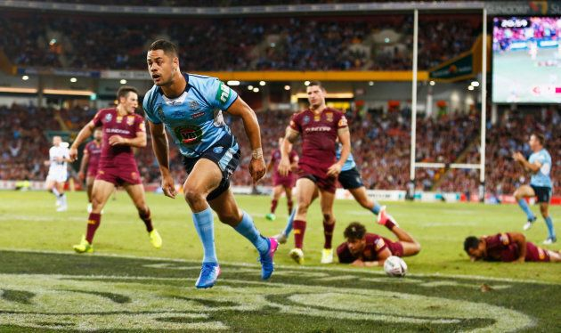 BRISBANE, AUSTRALIA: BRISBANE, AUSTRALIA: BRISBANE, AUSTRALIA: Jarryd Hayne of the Blues scores a try...