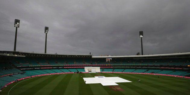 SYDNEY, AUSTRALIA - JANUARY 06: Rain continues to fall during day four of the third Test match between...