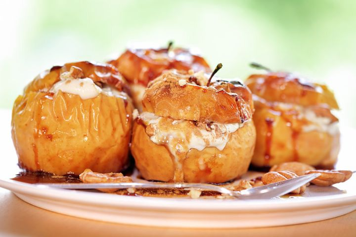 Stuff the apples with yoghurt and bake until golden.