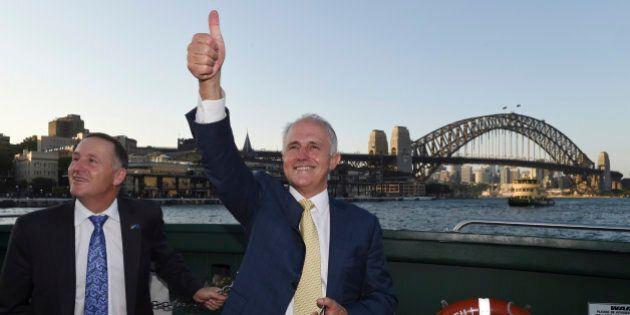 Australian Prime Minister Malcolm Turnbull, right, and New Zealand Prime Minister John Key travel on...