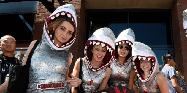 Women promoting Sharknado 3 dance on Fifth Avenue on Preview Night at Comic-Con International held at...