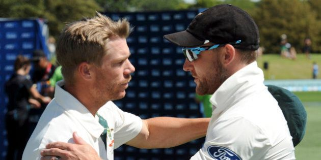 Australia's David Warner, left, and New Zealand's Brendon McCullum shake hands as McCullum retires...