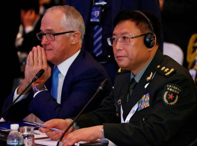 Prime Minister Malcolm Turnbull sitting next to China's  Vice President of Academy of Military Science, He Lei, at the Shangri-La Dialogue.