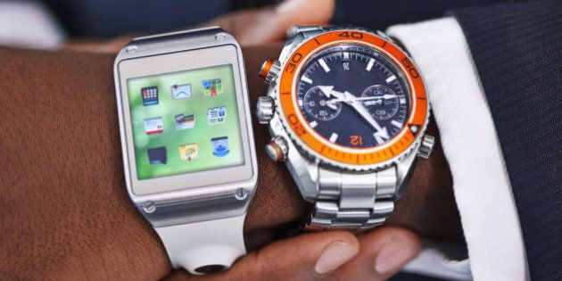 Cropped view of a young businessman wearing a smartwatch and a traditional watch - All screen content...