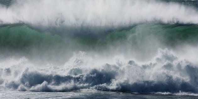 SHELLHARBOUR, AUSTRALIA - JUNE 20: Large swells roll in off Red Sands Beach at Bass Point, brought about...