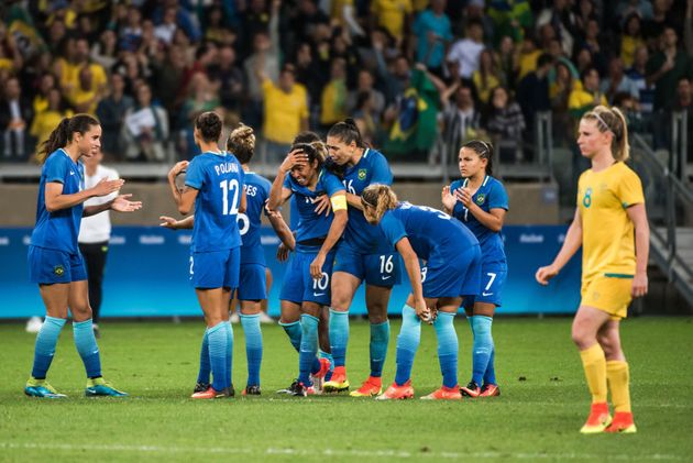 Brazilian players comfort Marta after she