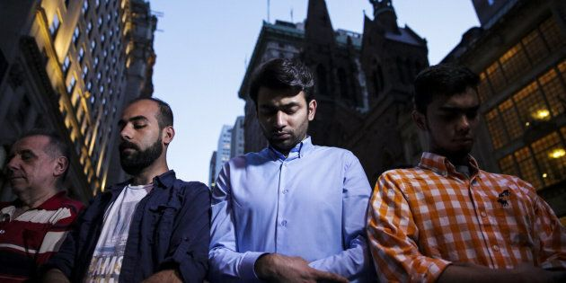 Demonstrators pray during an Iftar outside of Trump Tower in New York, U.S., on Thursday, June 1, 2017. The Justice Department vowed to challenge an appeals court ruling that slammed a travel ban against six Muslim majority nations as being 'steeped in animus,' putting President Donald Trump on track for his first Supreme Court showdown. Photographer: Jeenah Moon/Bloomberg via Getty Images
