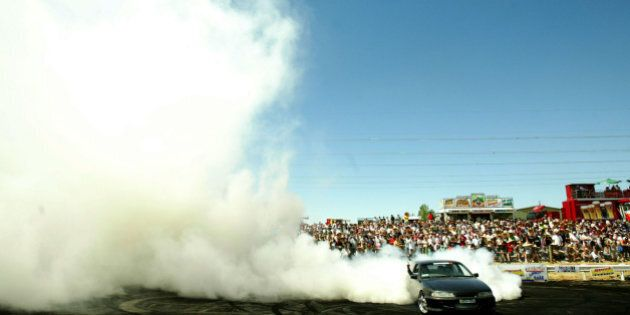 (AUSTRALIA & NEW ZEALAND OUT) Summernats 19 car festival held in Canberra over four days that brings people from around Australia to the capital. The final of the burnout competition was held as the final event of the festival, 8 January 2006. SMH Picture by CHRIS LANE (Photo by Fairfax Media/Fairfax Media via Getty Images)