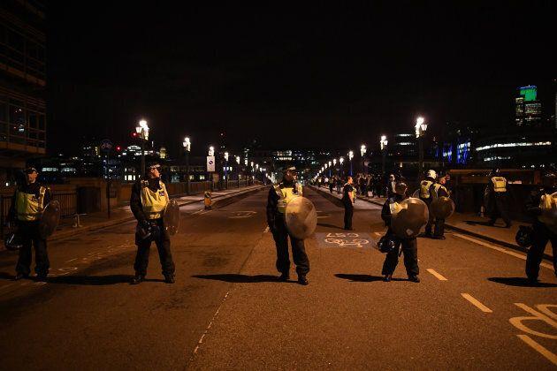 Police at the scene at Southwark Bridge.