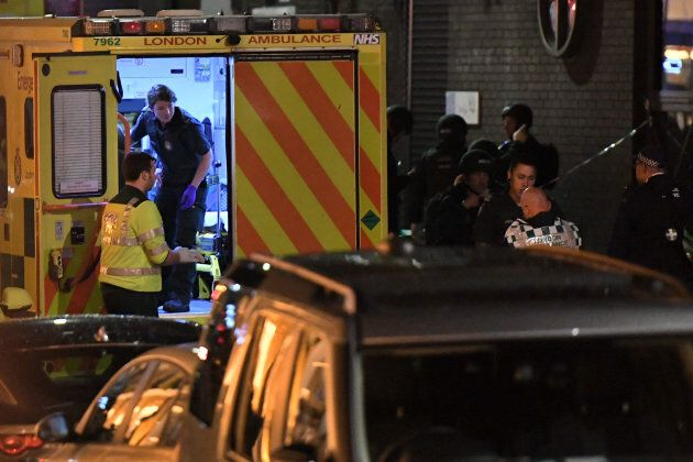 Police and members of the emergency services work at the scene of a terror attack.