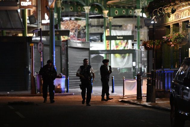 Armed police officers patrol in Borough Market.