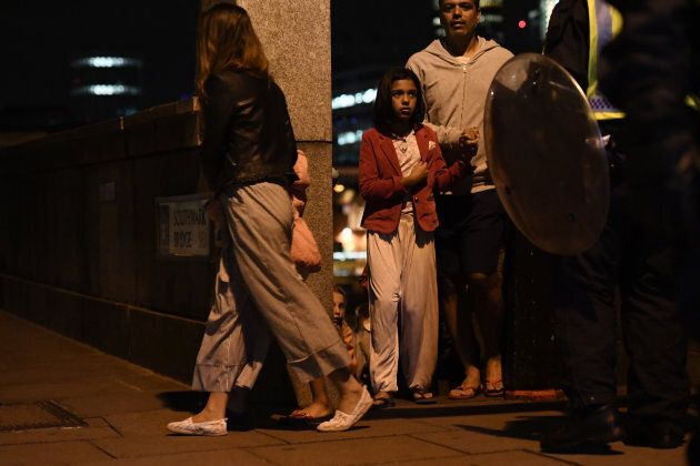 People are lead to safety on Southwark Bridge away from London