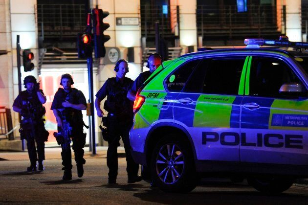 Armed police take position at the scene of a terror attack.