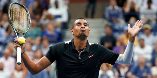 Nick Kyrgios, of Australia, reacts between points against Andy Murray, of Britain, during the first round...