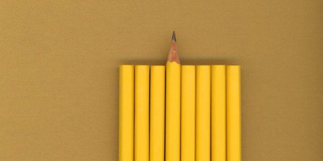 Sharpened pencil next to unsharpened pencils