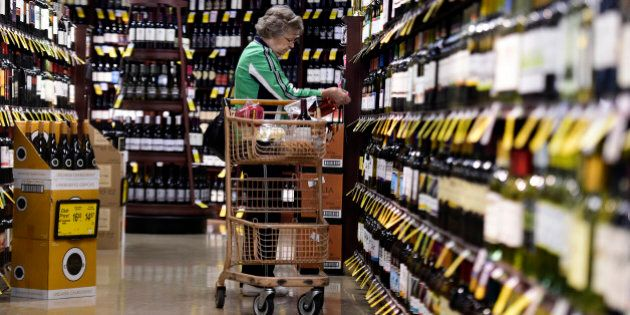 LITTLETON, CO - OCTOBER 20: Gail Morin shops for wine at her local Safeway, which she says is convenient...