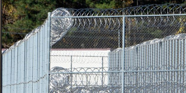 BUTNER, NC - NOVEMBER 20: The fence around the federal prison in Butner, North Carolina where convicted...