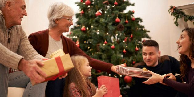 Shot of a multi-generational family exchanging gifts at