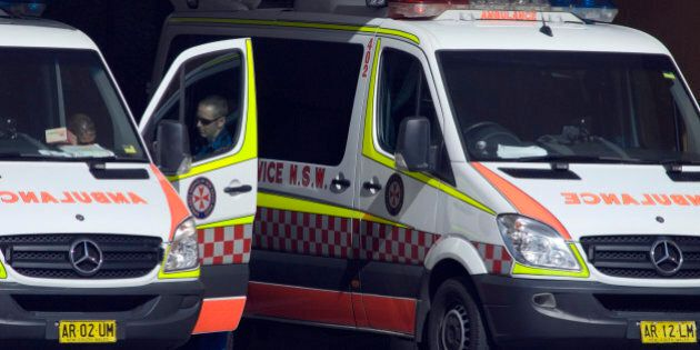 Ambulances are parked outside a hospital in Sydney, Australia, on Tuesday, May 4, 2010. The Australian...