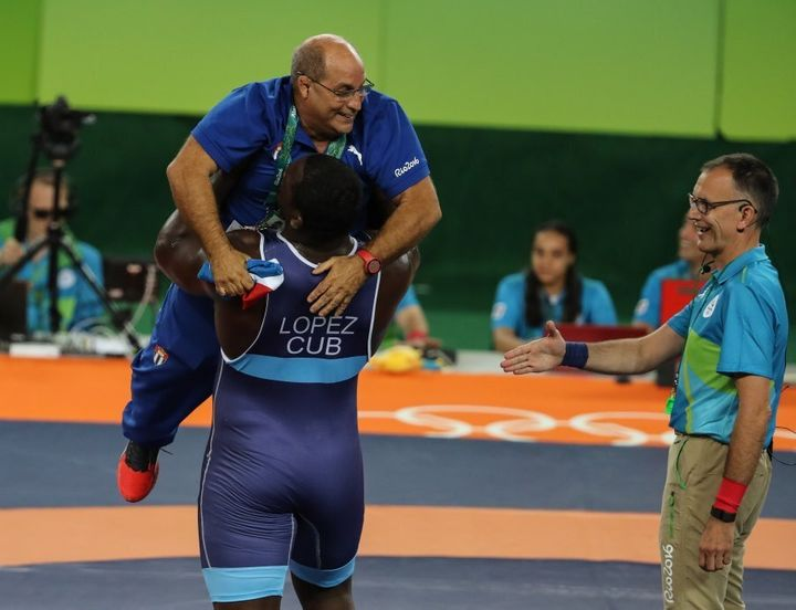 He actually flipped his coach onto the mat after this, but we couldn't find a pic of that.