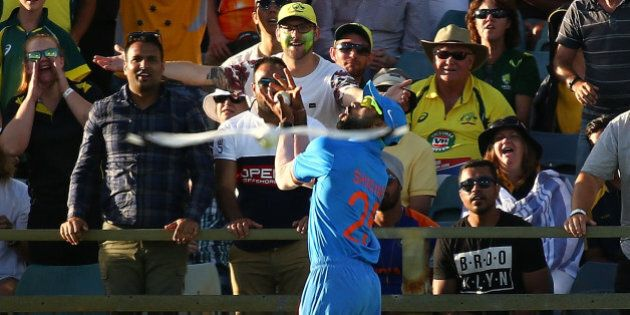 PERTH, AUSTRALIA - JANUARY 12:  Shikhar Dhawan of India takes a catch to dismiss Glenn Maxwell of Australia during the Victoria Bitter One Day International Series match between Australia and India at WACA on January 12, 2016 in Perth, Australia.  (Photo by Paul Kane/Getty Images)