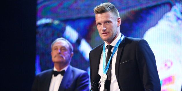 MELBOURNE, AUSTRALIA - NOVEMBER 23: Sam Groth, winner of the Newcombe Medal speaks on stage as John Newcombe...
