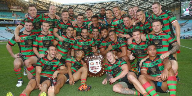 SYDNEY, AUSTRALIA - FEBRUARY 13: The Rabbitohs team celebrate with the Charity Shield after victory during...