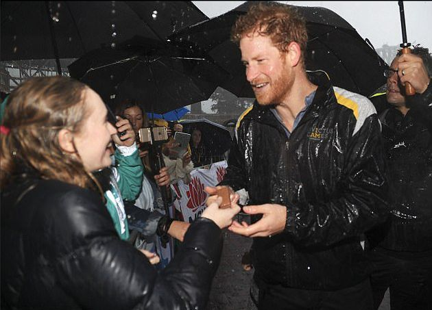 Prince Harry Meeting Fans In The Pouring Rain Will Warm Your