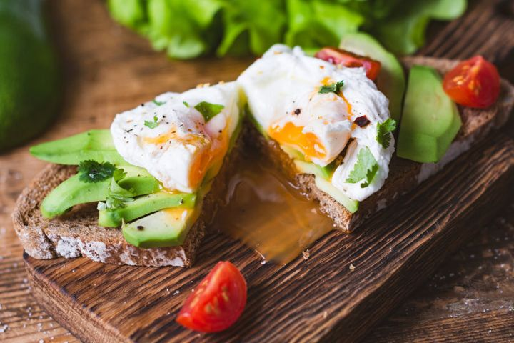 Eggs on whole grain toast with avocado and veggies is perfect post-workout fuel.