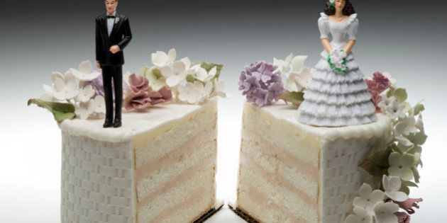 Bride and groom figurines standing on two separated slices of wedding