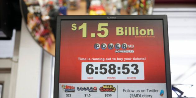 A sign for the Powerball jackpot is seen at the Sunnybrook Tavern and Liquor Store, Wednesday, Jan. 13, 2016 in Fort Washington, Md. The estimated Powerball jackpot was holding steady at $1.5 billion just hours ahead of Wednesday, Jan. 13, 2016, night's drawing, though same-day ticket sales could push the record-breaking amount even higher. (AP Photo/Alex Brandon)